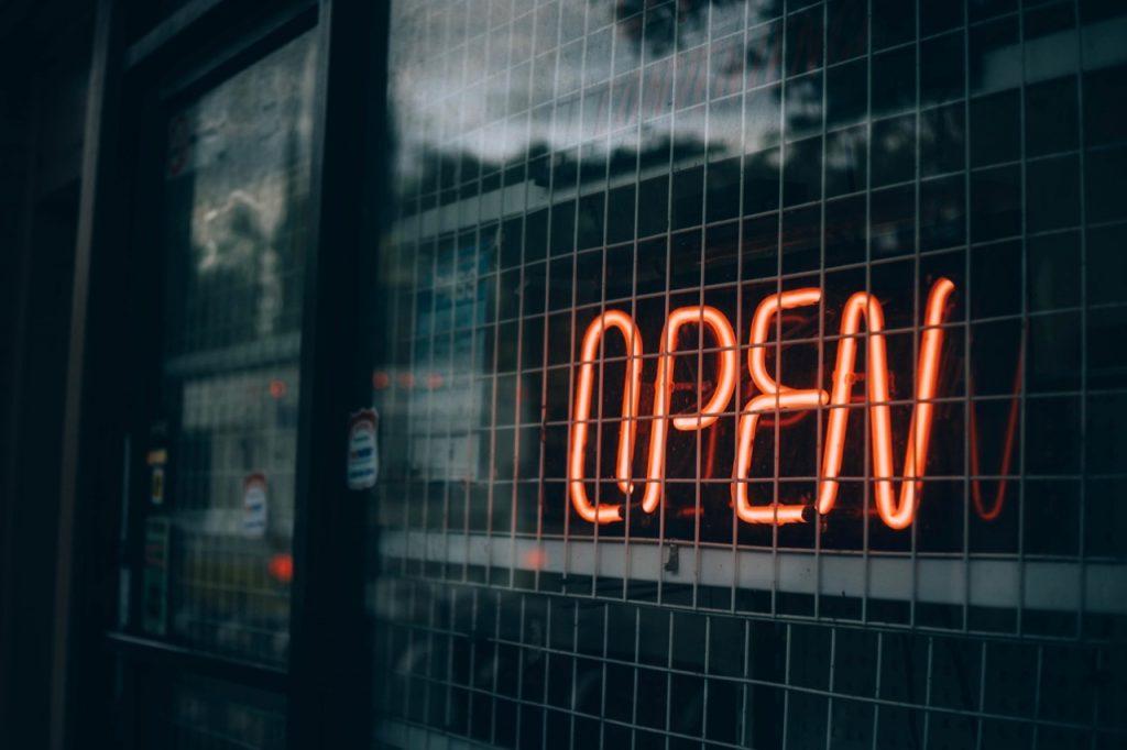 neon open sign on dark background